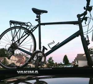 A Sirrus Sport road bike on a Yakima rack